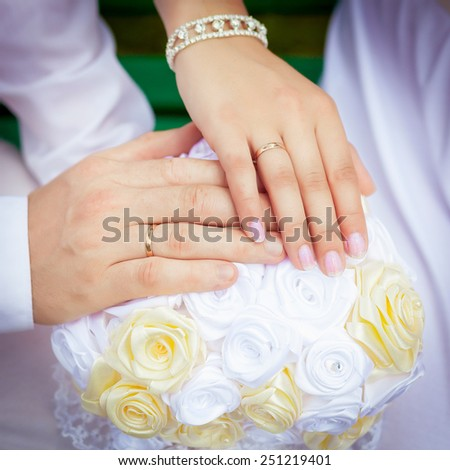 Bride and groom's hands with wedding rings. - stock photo