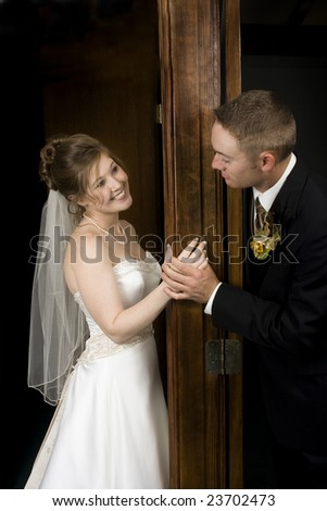 Bride and groom seeing each other for the first time - stock photo