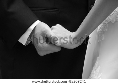 Bride and Groom showing Affection