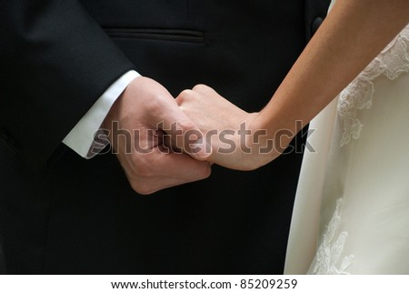Bride and Groom showing Affection - stock photo