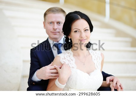 bride and groom sitting on the stairs