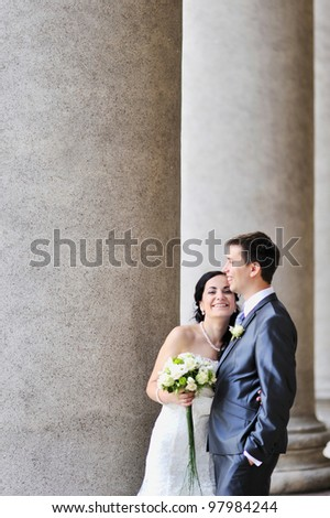 Bride and groom smiling at the church after a wedding ceremony