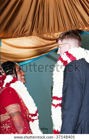 Bride and Groom taking part in a traditional Indian wedding ceremony - stock photo