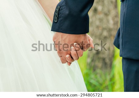 bride and groom to hold hands. Family love