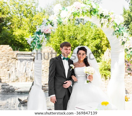 Bride and Groom Under Archway  - stock photo