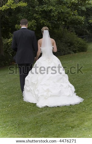 bride and groom walking outside