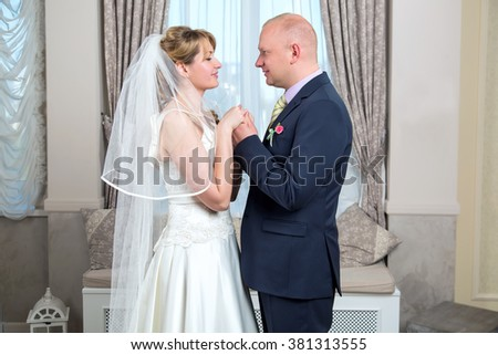 Bride and groom. Wedding. Adult man and woman bride and groom. Late marriages. Wedding unions. Marry after thirty. - stock photo