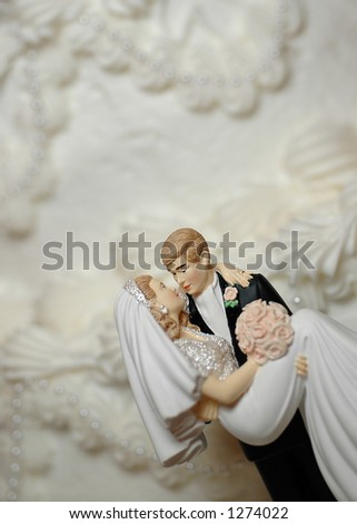 Bride and Groom Wedding Cake Figurines (room for text) - stock photo