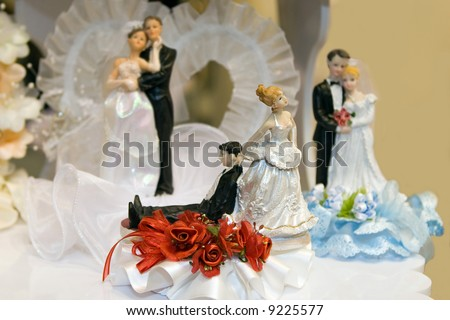 Bride and Groom Wedding Cake Ornaments of your choice - stock photo