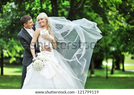 Bride and groom. Wedding couple in a park - stock photo