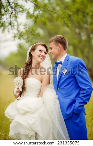 Bride and groom wedding day, newly married wedding couple outdoors, marriage day, Kissing man and woman. Happy newlywed family dancing outdoor. Loving couple, series. soft selective focus and sunset - stock photo