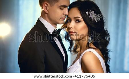 Bride and groom - wedding elegant photo. Bride in a luxury white wedding dress holding bouquet - stock photo
