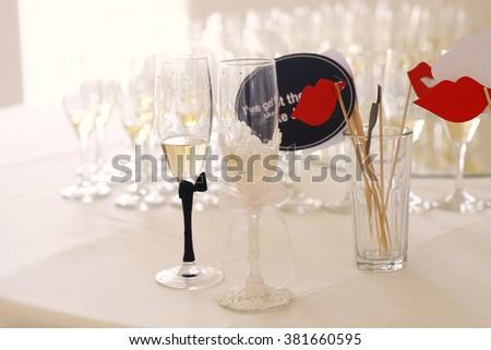 Bride and groom wedding glasses - stock photo