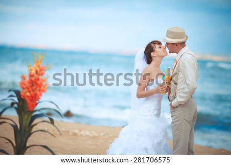 Bride and groom wedding portrait outdoors newlyweds loving couple sea tropical marriage bridal flowers, kissing man and woman at wedding day, selective focus, series