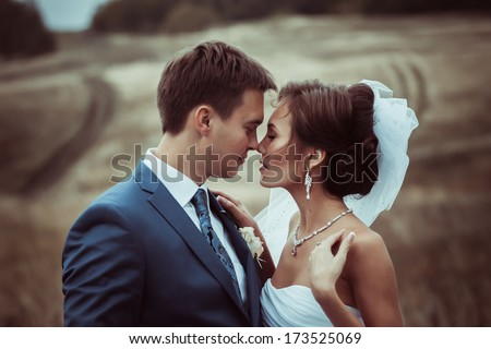 Bride and groom wedding portraits in nature - stock photo