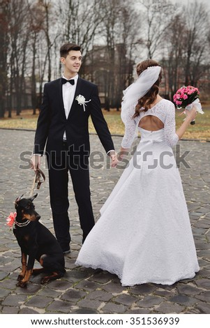 Bride and groom wedding with dog