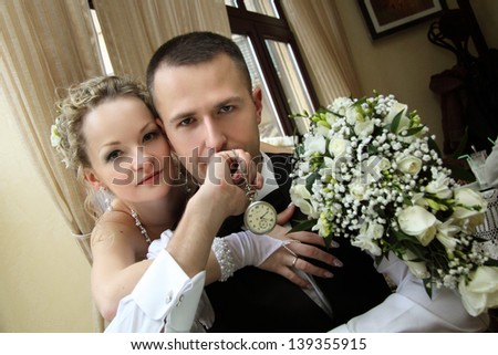 bride and groom with a bouquet of flowers - stock photo