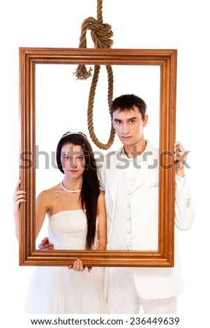 Bride and groom with a hanging rope. - stock photo