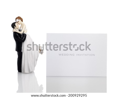 Bride and Groom with a wedding invitation - stock photo