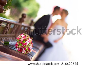 Bride and groom with bridal bouquet in front