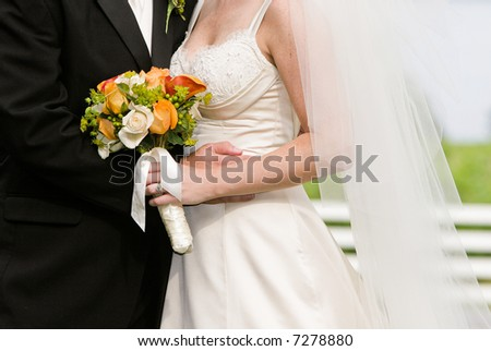 bride and groom with flowers - stock photo