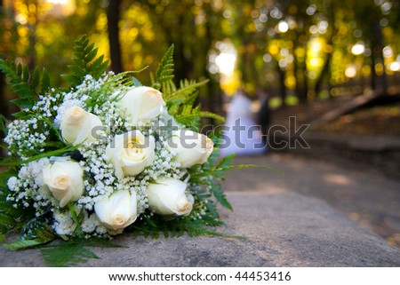 bride and groom with wedding bouquet - stock photo