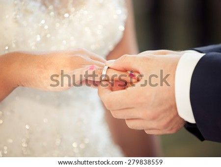 Bride and groom with wedding rings - stock photo