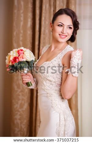 Bride and her wedding bouquet, portrait shot - stock photo