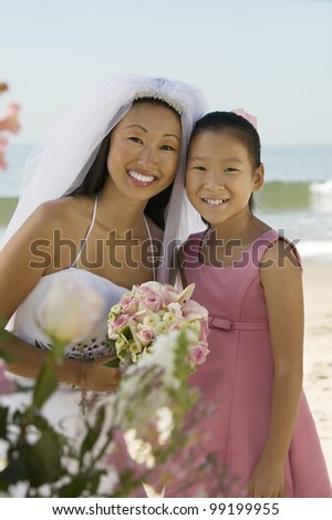 Bride and Sister on Beach - stock photo