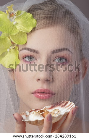 Bride and wedding rings - stock photo