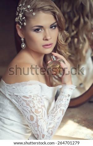 bride applying perfume  - stock photo