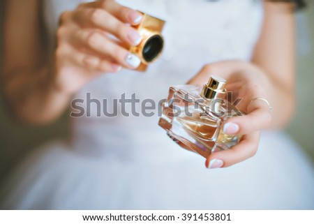 bride applying perfume on her wrist