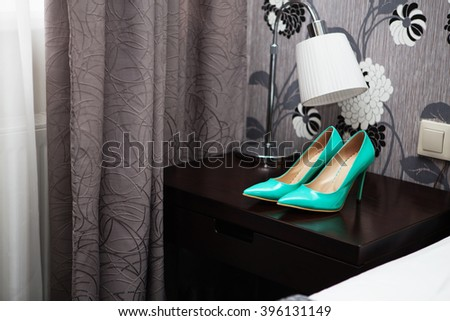 Bride attributes. Morning of the bride. Wedding blue patent leather high-heeled shoes. Preparations for the wedding ceremony - stock photo