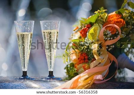 Bride bouquet with glass of champagne - stock photo
