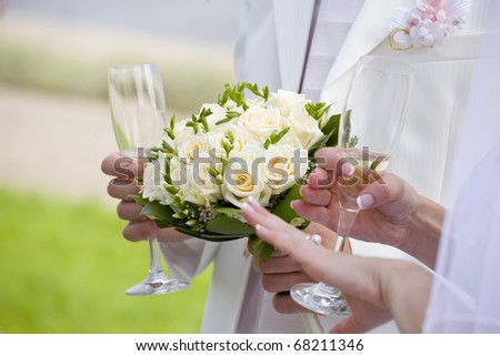 Bride checks her nails - stock photo