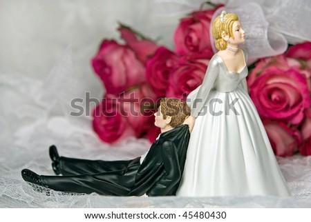 bride dragging groom - stock photo