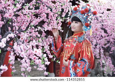 bride dressed in traditional Chinese wedding - stock photo