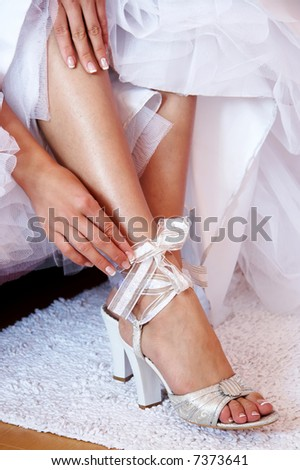 Bride dressing shoes. Leg of young woman in shoes. - stock photo