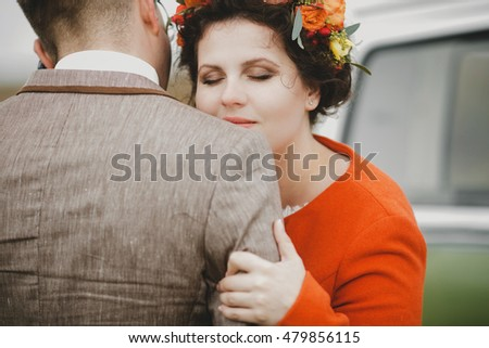 bride gently hugged groom from behind