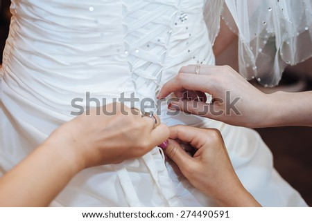 Bride getting ready. beautiful bride in white wedding dress with hairstyle and bright makeup. Happy sexy girl waiting for groom. Romantic lady in bridal dress have final preparation for wedding - stock photo