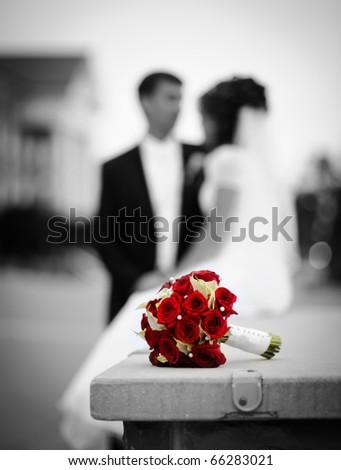 Bride, groom and wedding bouquet - stock photo