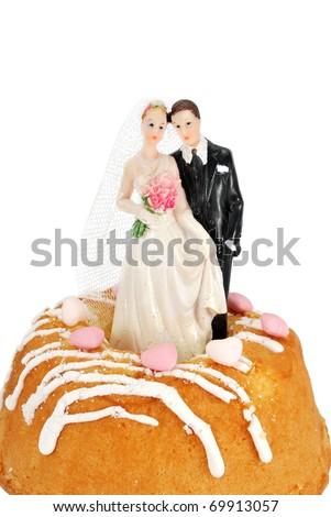 bride groom figurines on a cake - stock photo