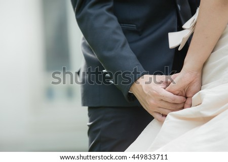 Bride groom holding hands as a symbol of love and happiness. - stock photo