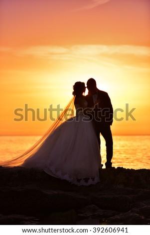 bride groom sunset - stock photo