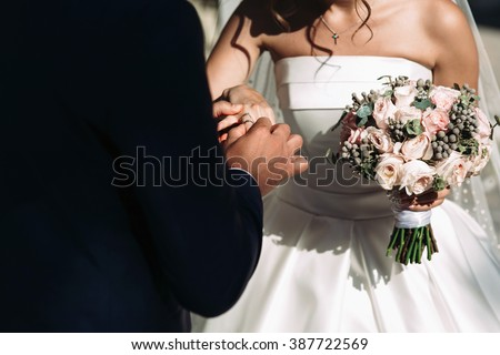 Bride & groom taking vows at white aisle, wedding ceremony closeup - stock photo
