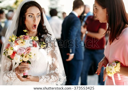 Bride, guests and bridesmaids at  wedding ceremony outdoors - stock photo