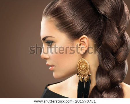 Bride hairstyle. Beautiful Woman with Healthy Long Hair. Hairdressing. Hairstyle. Beauty Glamour Fashion Model Girl Portrait. Perfect Skin and Makeup  - stock photo