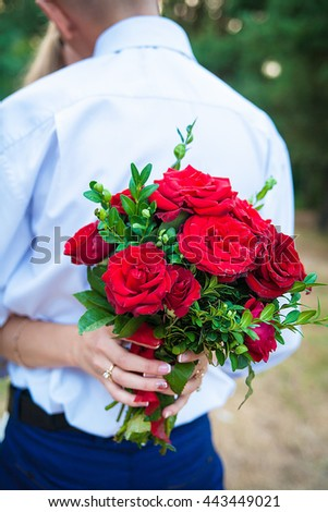 Bride holding a beautiful bouquet of red roses