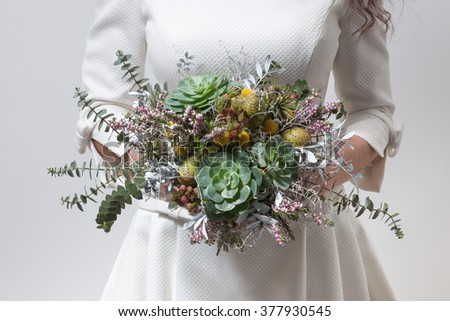 Bride holding a wild flowers inspired wedding bouquet