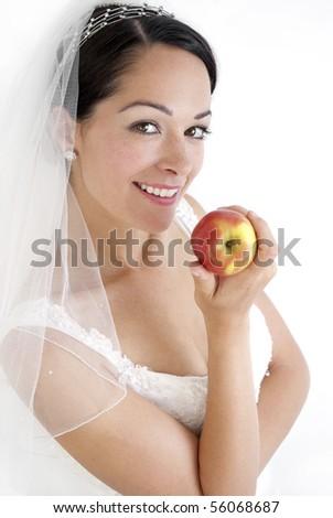 Bride holding apple - stock photo